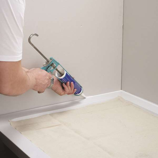 bathroom sealant with and the nz bathtub warehouse smoothing stick a apply bunnings silicone popsicle diy person showers applybathroomsealant advice how baths toilets to