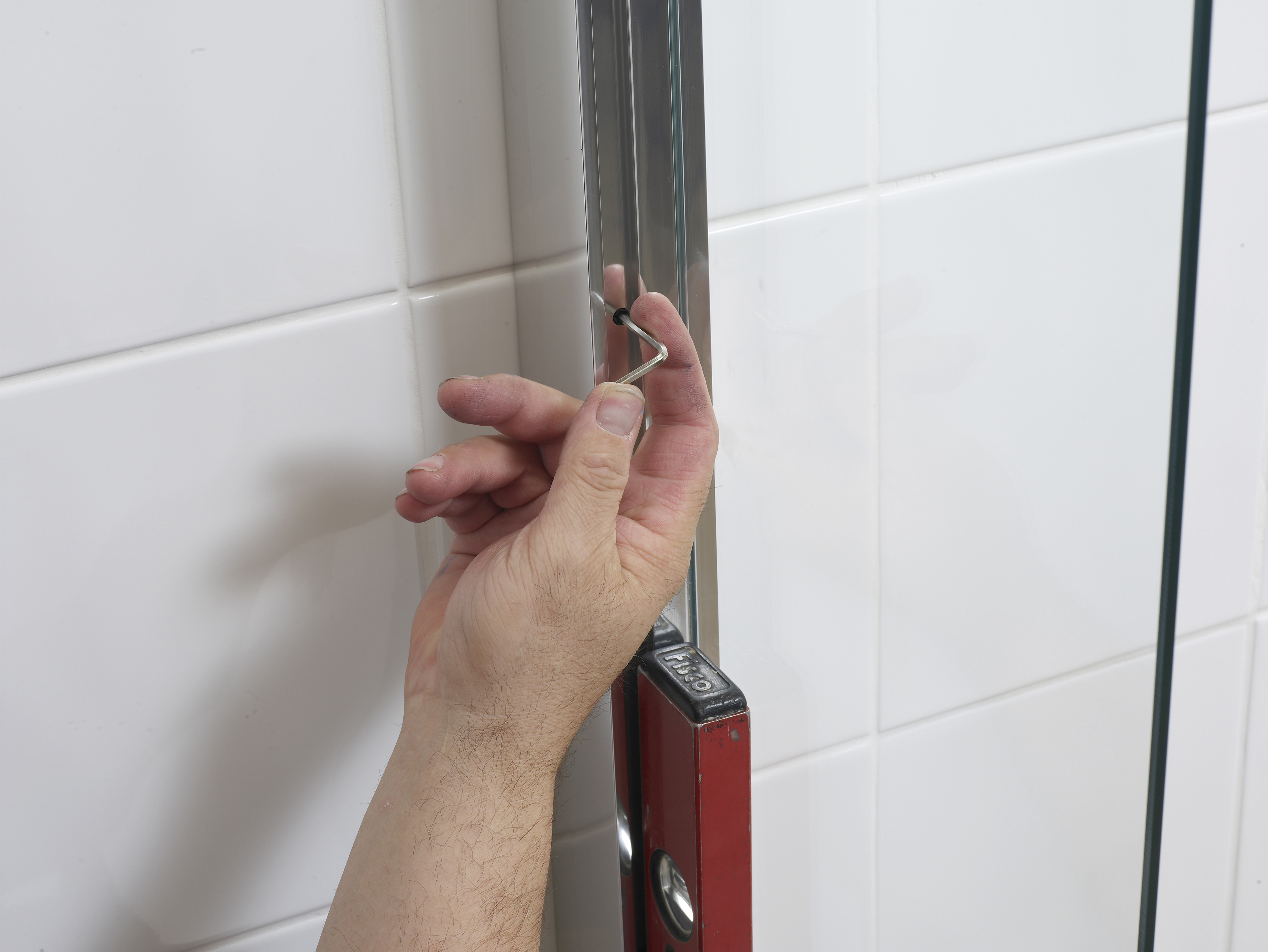 Use the 3mm Allen key to lock the quad frame into both wall channels