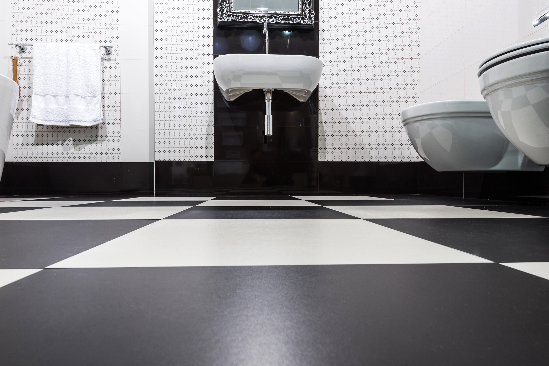 Bathroom with black and white floor tiles
