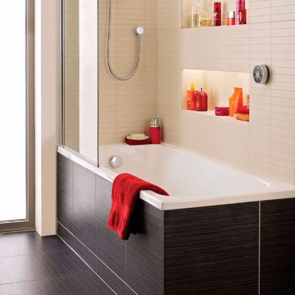 Bathroom set up with in wall shelving and orange and red accessories